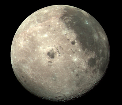 The picture was taken by the spacecraft Galileo as it flew past the Moon in 1990. Galileo was able to observe the Moon's surface from an angle that is not possible from the Earth, due to the fact that the same side of the Moon always faces the Earth.