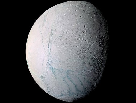 As it swooped past the south pole of Saturn's moon Enceladus on 14 July 2005, Cassini acquired high resolution views of this puzzling ice world. From afar, Enceladus exhibits a bizarre mixture of softened craters and complex, fractured terrains.