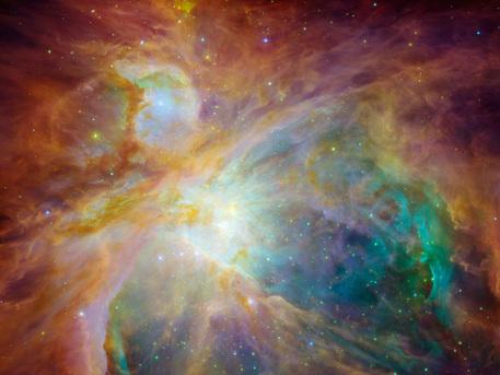 Fotos der beiden NASA-Weltraumteleskope Spitzer und Hubble wurden bei dieser Aufnahme des chaotischen Inneren des 1500 Lichtjahre entfernten Orion-Nebels kombiniert.