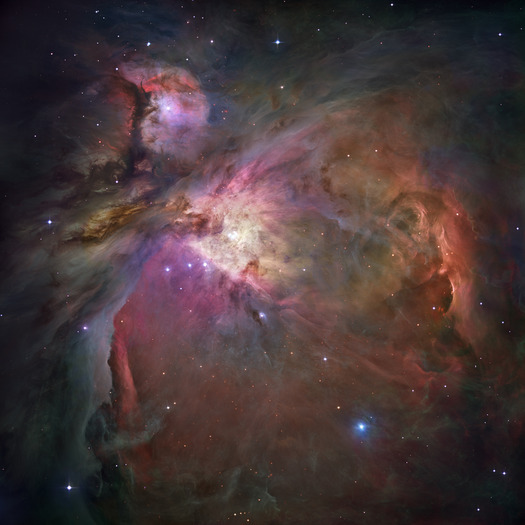 This Hubble Space Telescope picture shows the Orion Nebula. It shines because its gas is excited to emit light by the radiation of nearby stars.