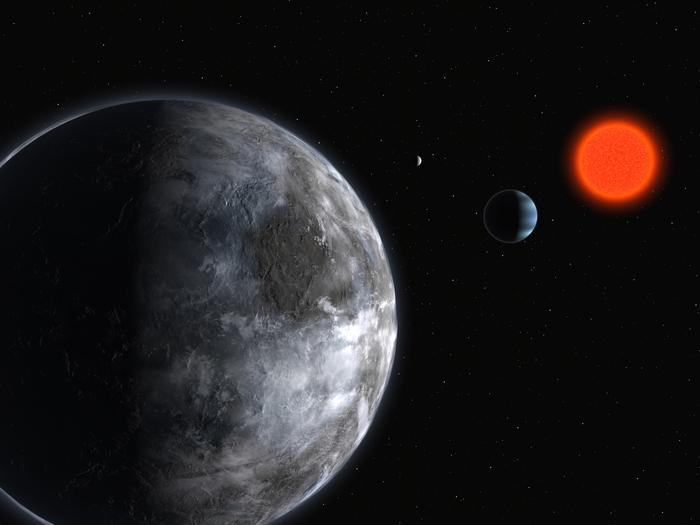 """Diese künstlerische Darstellung zeigt den Stern Gliese 581, einen """"Roten Riesen"""", der sich in etwas mehr als 20 Lichtjahren Entfernung von der Erde befindet. Hypothetische """"Bewohner"""" der den Stern umkreisenden Planeten 581c (im Vordergrund), 581b und 581d (der kleinste der dargestellten Planeten) könnten theoretisch in Kürze die von der Erde ausgehenden und sich mit Lichtgeschwindigkeit durchs All fortpflanzenden Signale vom Mauerfall am 9. November 1989 empfangen."""