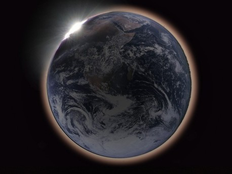 If you travel to the Moon's near side, you could see a lunar eclipse as a solar eclipse, with the disk of our fair planet Earth completely blocking out the Sun. For a moon-based observer's view, graphic artist Hana Gartstein (Haifa, Israel) offers this composite illustration. In the cropped version of her picture, an Apollo 17 image of Earth is surrounded with a red-tinted haze as sunlight streams through the planet's dusty atmosphere. Earth's night side remains faintly visible, still illuminated by the dark, reddened Moon, but the disk of the Earth would appear almost four times the size of the Sun's disk, so the faint corona surrounding the Sun would be largely obscured. At the upper left, the Sun itself is just disappearing behind the Earth's limb.