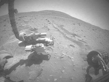 """Spirit attempted to turn all six wheels on Sol 2126 (Saturday, Dec. 26, 2009) to extricate itself from the sand trap known as """"Troy,"""" but stopped earlier than expected because of excessive sinkage. Telemetry indicates that the rover moved forward 3 millimeters (0.12 inch), left 2 millimeters (0.08 inch) and down (sinkage) 6 millimeters (0.24 inch). The right-front and right-rear wheels did not move."""