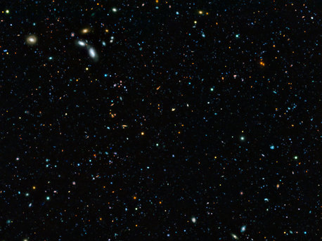 This composite image of the GOODS-South field — the result of an extremely deep survey using two of the four giant 8.2-metre telescopes composing ESO's Very Large Telescope (VLT) and a unique custom-built filter — shows some of the faintest galaxies ever seen. It also allows astronomers to determine that 90% of galaxies whose light took 10 billion years to reach us have gone undiscovered.