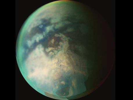 Image from NASA's Cassini spacecraft of Saturn's moon Titan. This image is a composite of several images taken during two separate Titan flybys on Oct. 9 (T19) and Oct. 25 (T20). The large circular feature near the center of Titan's disk may be the remnant of a very old impact basin. The mountain ranges to the southeast of the circular feature, and the long dark, linear feature to the northwest of the old impact scar may have resulted from tectonic activity on Titan caused by the energy released when the impact occurred.