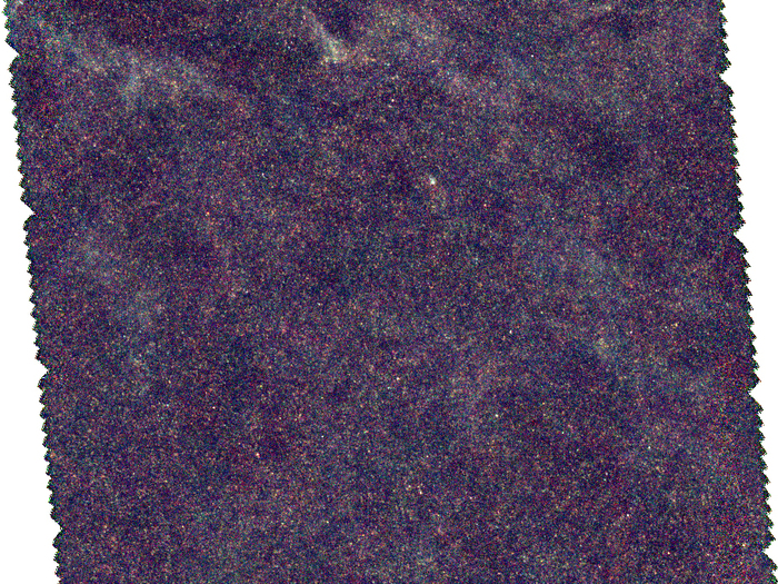 Galaxias lejanas tras la nube de gas de la Vía Láctea, observadas por Herschel