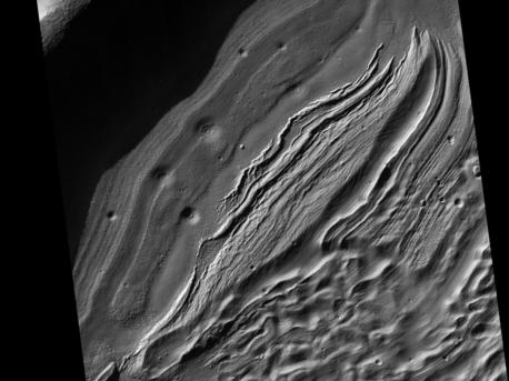 This subimage from an observation by the High Resolution Imaging Science Experiment (HiRISE) camera on NASA's Mars Reconnaissance Orbiter covers a small portion of the northwest quadrant of Hellas Basin, or Hellas Planitia, on southern Mars. With a diameter of about 2,200 kilometers (about 1,400 miles) and a depth reaching the lowest elevations on Mars, Hellas is one of the largest impact craters in the solar system. This area of Hellas Basin has a number of unusual features which are thought to be quite old because of the high crater density. Here a crater inside Hellas has been filled with material. This may be related to volcanic activity on the northwestern rim of Hellas. However, it might also be related to water and water ice. There is evidence elsewhere that the ground here is ice-rich. HiRISE is being used to investigate this in more detail when Hellas Basin is free from atmospheric dust.