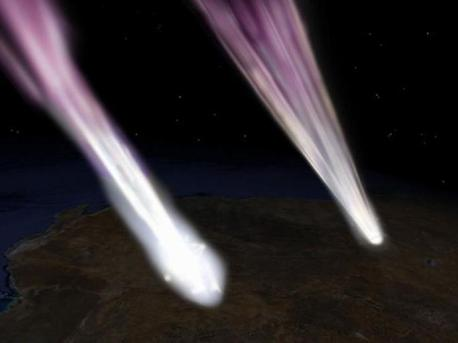 This artist's concept depicts the Hayabusa spacecraft (left) and sample return capsule (right) entering the atmosphere over South Australia.