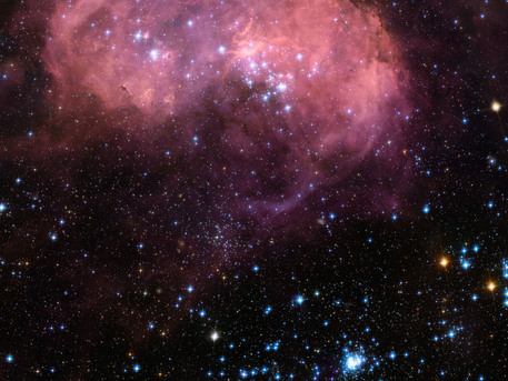 This broad vista of young stars and gas clouds in our neighbouring galaxy, the Large Magellanic Cloud, was captured by the NASA/ESA Hubble Space Telescope's Advanced Camera for Surveys (ACS). This region is named LHA 120-N 11, informally known as N11, and is one of the most active star-forming regions in the nearby Universe. This picture is a mosaic of ACS data from five different positions and covers a region of about 6 arcmin across.