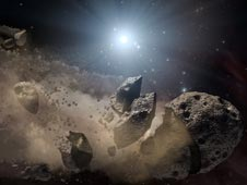 "NASA's Spitzer Space Telescope set its infrared eyes upon the dusty remains of shredded asteroids around several dead stars. This artist's concept illustrates one such dead star, or ""white dwarf,"" surrounded by the bits and pieces of a disintegrating aste"