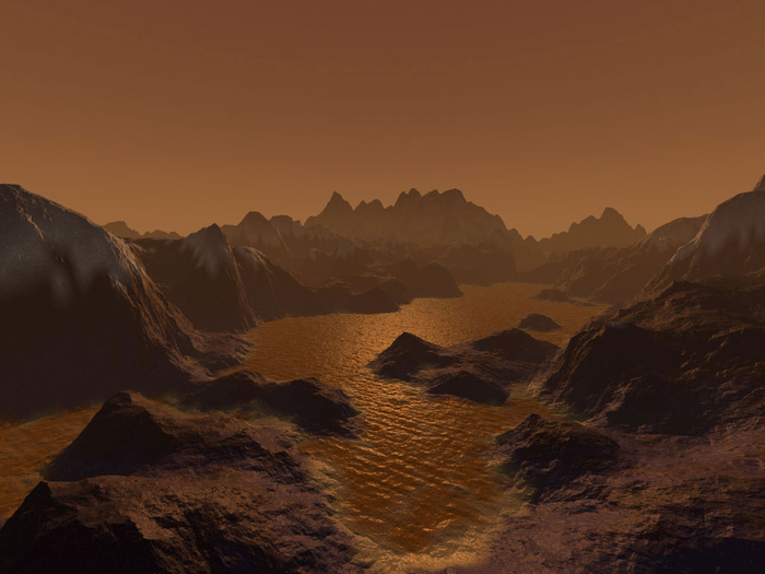 An artist's imagination of hydrocarbon pools, icy and rocky terrain on the surface of Saturn's largest moon Titan.