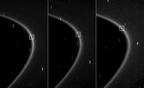 This sequence of three images, obtained over the course of about 10 minutes, shows the path of a newly found moonlet in a bright arc of Saturn's faint G ring. Note that this streak is aligned with the G ring and moves along the ring.