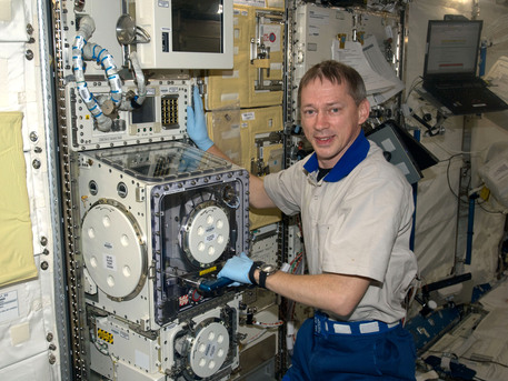 ESA astronaut Frank De Winne, Expedition 20 flight engineer, works at the Clean Bench Facility in the Kibo laboratory of the International Space Station.