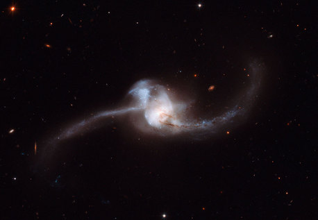 The product of this dramatic collision, called NGC 2623, or Arp 243, is about 250 million light-years away in the constellation of Cancer (the Crab).