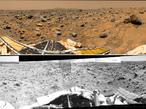 """Dieses Bild zeigt den Rover Sojourner, der nach dem Verlassen der Landestation über die gelbe Rampe im Vordergrund, vorbei am Felsen """"Barnacle Bill"""", mit der Untersuchung von """"Yogi"""" beginnt."""