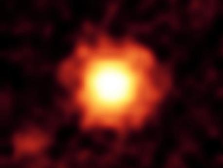 NASA's Spitzer Space Telescope captured this infrared image of a giant halo of very fine dust around the young star HR 8799.