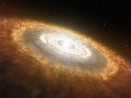 Impresión artística de una estrella bebé todavía rodeada por un disco protoplanetario en el que los planetas se están formando.