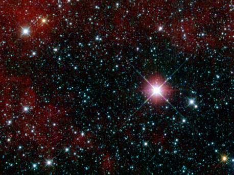 """This infrared snapshot of a region in the constellation Carina near the Milky Way was taken shortly after NASA's Wide-field Infrared Survey Explorer (WISE) ejected its cover. The """"first-light"""" picture shows thousands of stars and covers an area three times the size of the moon. WISE will take more than a million similar pictures covering the whole sky."""