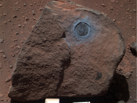"NASA's Mars Exploration Rover Opportunity examined a rock called ""Marquette Island."" Studies of texture and composition suggest that this rock, not much bigger than a basketball, originated deep inside the Martian crust. A crater-digging impact could have excavated the rock and thrown it a long distance, to where Opportunity found it along the rover's long trek across the Meridiani plain toward Endeavour Crater."
