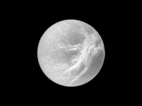 Appearing like the swirls of marble, the wispy terrain of Saturn's moon Dione is captured in a dramatic display of light and dark. These wispy features are a system of braided canyons with bright walls. This view looks toward the area between the trailing hemisphere and Saturn-facing side of Dione (1,123 kilometers, or 698 miles across). North on Dione is up and rotated 1 degree to the left. The image was taken in visible light with the Cassini spacecraft narrow-angle camera on Dec. 26, 2009. The view was acquired at a distance of approximately 644,000 kilometers (400,000 miles) from Dione and at a Sun-Dione-spacecraft, or phase, angle of 2 degrees. Image scale is 4 kilometers (2 miles) per pixel.