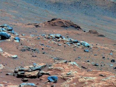 """Lengthy detective work with data NASA's Mars Exploration Rover Spirit collected in late 2005 has confirmed that an outcrop called """"Comanche"""" contains a mineral indicating that a past environment was wet and non-acidic, possibly favorable to life.  Spirit used its panoramic camera to capture this view of the Comanche outcrop during the 689th Martian day, or sol, of the rover's mission on Mars (Dec. 11, 2005). The rover's Moessbauer spectrometer, miniature thermal emission spectrometer and alpha particle X-ray spectrometer each examined targets on Comanche that month. On June 3, 2010, scientists using data from all three spectrometers reported that about one-fourth of the composition of Comanche is magnesium iron carbonate. That concentration is 10 times higher than for any previously identified carbonate in a Martian rock.  Carbonates originate in wet, near-neutral conditions but dissolve in acid. The find at Comanche is the first unambiguous evidence from either Spirit of its twin, Opportunity, for a past Martian environment that may have been more favorable to life than the wet but acidic conditions indicated by the rovers' earlier finds.  In this image, Comanche is the dark reddish mound above the center of the view. The image is presented in false color, which makes some differences between materials easier to see. It combines three separate exposures taken through filters admitting wavelengths of 750 nanometers, 530 nanometers and 430 nanometers. The main Comanche outcrop is about 5 meters (16 feet) from left to right from this perspective. The paler material visible at bottom right is part of another outcrop, """"Algonquin."""""""