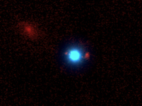 This unlabeled image of the first-ever foreground quasar (blue) lensing a background galaxy (red) was taken with the Keck II telescope and its NIRC-2 instrument using laser guide star adaptive optics. Discovering more of these lenses will allow astronomers to determine the masses of quasars' host galaxies.