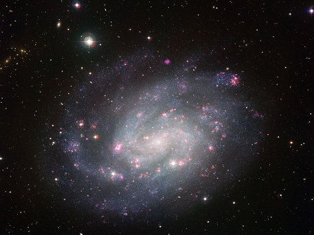This picture of the spectacular southern spiral galaxy NGC 300 was taken using the Wide Field Imager (WFI) at ESO's La Silla Observatory in Chile. It was assembled from many individual images through a large set of different filters over many observing nights, spanning several years. The main purpose of this extensive observational campaign was to get an unusually thorough census of the stars in the galaxy, counting both the number and varieties of stars and marking regions, or even individual stars, that warrant deeper and more focussed investigation. But such a rich data collection will also have many other uses for years to come.  The images were mostly taken through filters that transmit red, green or blue light. These were supplemented by images through special filters that allow through only the light from ionised hydrogen or oxygen gas and highlight the glowing clouds in the galaxy's spiral arms. The total exposure time amounted to around 50 hours.