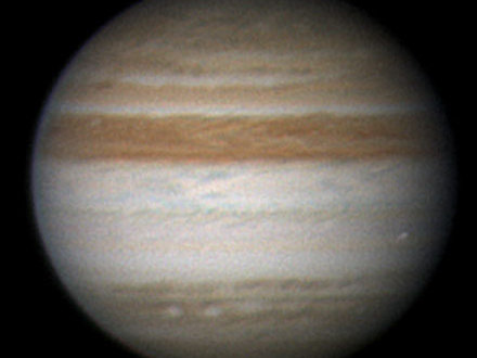 This image by amateur astronomer Christopher Go, of Cebu, Philippines, confirms that the glimmer amateur astronomer Anthony Wesley saw in his telescope on June 3, 2010, was an object burning up in the Jupiter atmosphere. Go obtained the image in blue wavelengths of light with a 28-centimeter (11-inch) telescope. He overlaid the blue-channel image on a color composite image of Jupiter.