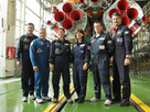 At the Baikonur Cosmodrome in Kazakhstan, the prime and backup crews to join Expedition 24 on the International Space Station pose for a picture in front of their Soyuz booster rocket in its integration building June 11, 2010. From left to right are prime crew members Doug Wheelock, Soyuz Commander Fyodor Yurchikhin and Shannon Walker, with backup crew members Cady Coleman, Dmitri Kondratiev and Paolo Nespoli of the European Space Agency. Wheelock, Yurchikhin and Walker will launch next week in the Soyuz TMA-19 spacecraft on a two-day trip to the International Space Station.
