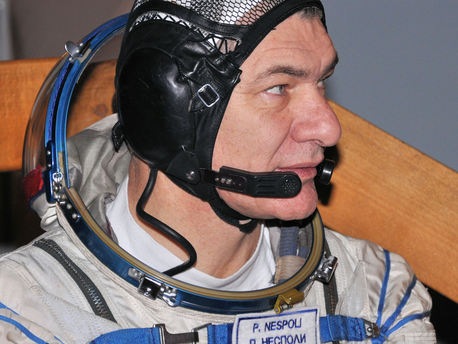 ESA's Italian astronaut Paolo Nespoli captured on the final exam day in his flight suit near the Soyuz TMA simulator.
