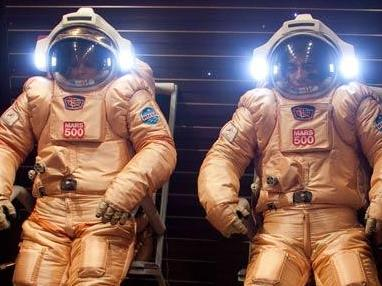 Mars500 crewmembers testing the Russian Orlan suits before their mission started in early June 2010.