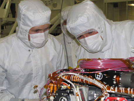 Image shows Grad student Nicholas Boyd (left) and Principal Investigator Ralf Gellert, both of the University of Guelph, Ontario, Canada, preparing for the installation of the sensor head on the Alpha Particle X-ray Spectrometer instrument during testing at NASA's Jet Propulsion Laboratory.The instrument is part of the Curiosity rover, which will fly on NASA's Mars Science Laboratory mission. The sensor head is 7.8 centimeters, or about 3 inches tall.