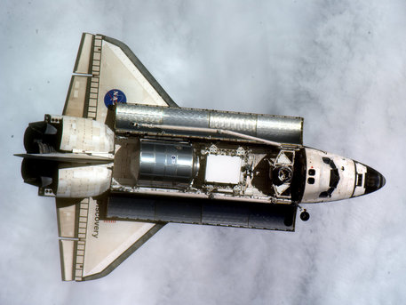 Discovery approaches the International Space Station for docking on 26 February 2011 with Leonardo module in its cargo bay.