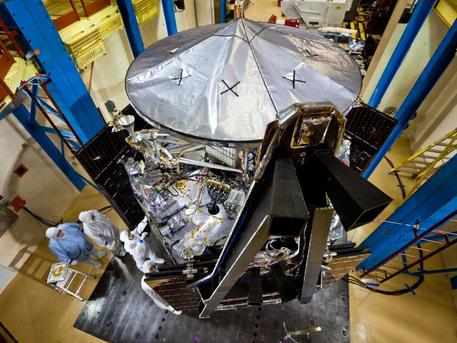 NASA's fully assembled Juno spacecraft is currently undergoing testing at Lockheed Martin Space Systems near Denver. Technicians are inspecting some of the spacecraft's components. All three solar array wings can be seen installed and stowed, and the spacecraft's large high-gain antenna in place on top. Juno is scheduled to ship from Lockheed Martin's facility to Kennedy Space Center in April, where it will undergo final preparations for launch in August 2011. The solar-powered spacecraft will orbit Jupiter's poles to find out more about the gas giant's origins, structure, atmosphere and magnetosphere.