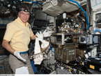 ESA astronaut Paolo Nespoli, Expedition 26 flight engineer, works on 1 March 2011 with the Light Microscopy Module (LMM) Spindle Bracket Assembly in the Fluids Integrated Rack (FIR) in the Destiny laboratory of the International Space Station.
