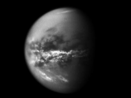 NASA's Cassini spacecraft chronicles the change of seasons as it captures clouds concentrated near the equator of Saturn's largest moon, Titan.  Methane clouds in the troposphere, the lowest part of the atmosphere, appear white here and are mostly near Titan's equator. The darkest areas are surface features that have a low albedo, meaning they do not reflect much light. Cassini observations of clouds like these provide evidence of a seasonal shift of Titan's weather systems to low latitudes following the August 2009 equinox in the Saturnian system. (During equinox, the sun lies directly over the equator. See PIA11667 to learn how the sun's illumination of the Saturnian system changed during the equinox transition to spring in the northern hemispheres and to fall in the southern hemispheres of the planet and its moons.)