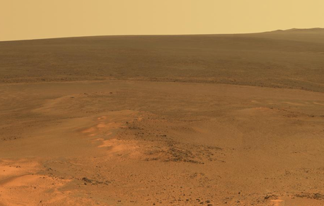 "This mosaic of images taken in mid-January 2012 shows the windswept vista northward (left) to northeastward (right) from the location where NASA's Mars Exploration Rover Opportunity is spending its fifth Martian winter, an outcrop informally named ""Greeley Haven."" Image credit: NASA/JPL-Caltech/Cornell/Arizona State Univ."
