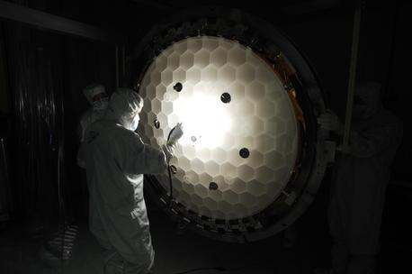 nspection of the primary mirror honeycomb structure. The mirror has been 86% light weighted. That is it only weighs 14% (1/7) that of a solid mirror of the same dimensions.