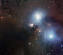 This pan shows many details in a gorgeous cosmic watercolour of the star-forming region around the star R Coronae Australis that was captured by the Wide Field Imager (WFI), on the MPG/ESO 2.2-metre telescope at ESO's La Silla Observatory. Fine details of the bluish reflection nebula and the huge surrounding dust cloud are visible. This star-forming region is located some 420 light-years away in the small constellation of Corona Australis (the Southern Crown).